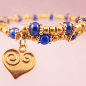 Blue and Gold Bead Wrap Bracelet with Heart and Four Leaf Clover