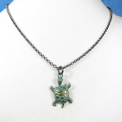 La Sirena Turtle Pendant on 22 Inch Gunmetal Rollo Chain